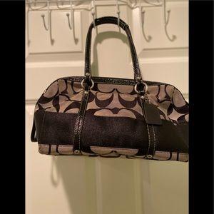 Medium size Coach purse.